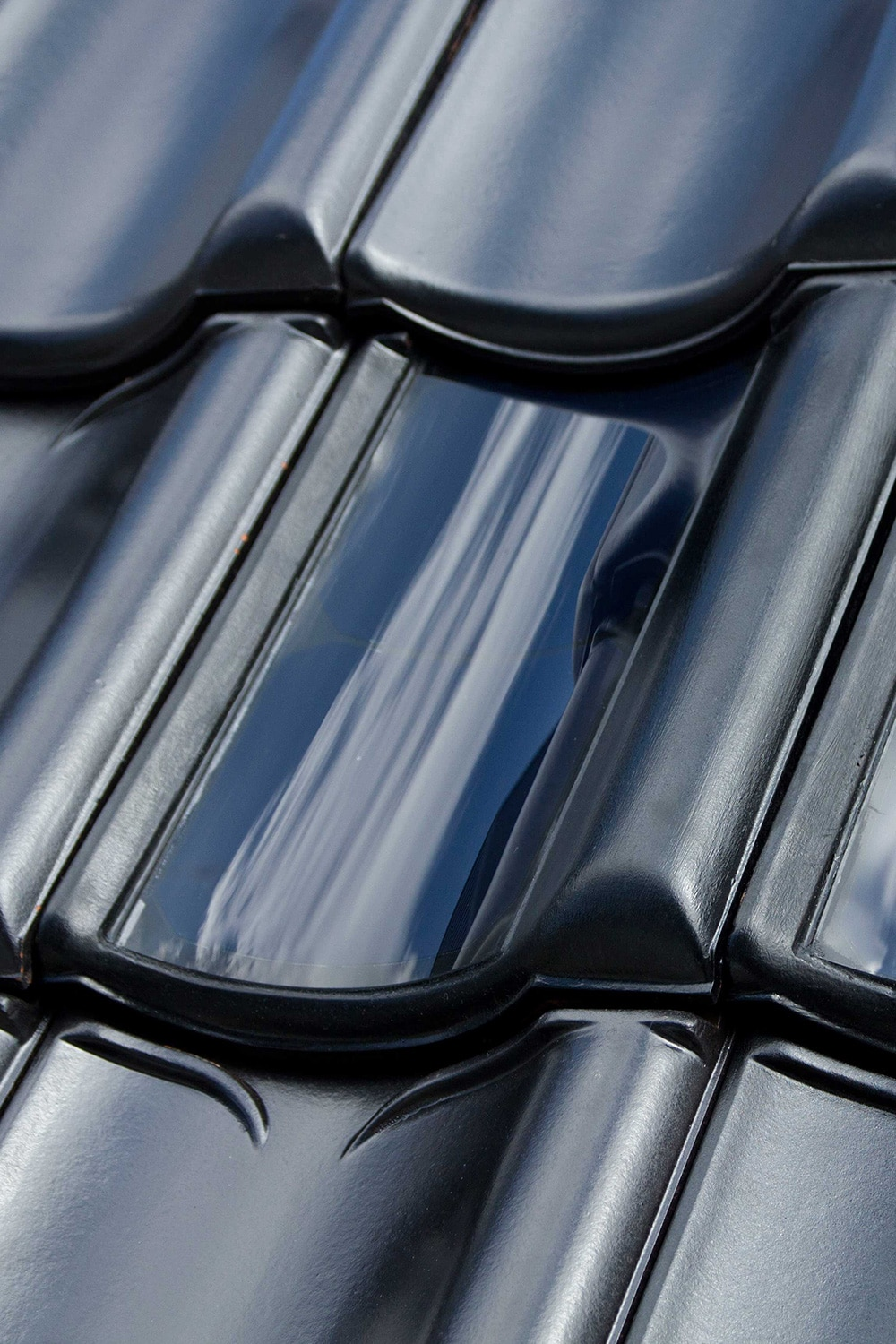 FlexSol solar PV roof tile - BiPV or building integrated PV in the form of a ceramic curved roof tile with flexible PV cells